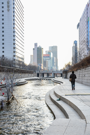 south space: People at Cheonggyecheon stream in winter. The stream is a modern public recreation space in downtown Seoul, South Korea Editorial