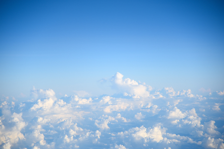 Beautiful aerial view of blue sky and white clouds, view from airplanes window