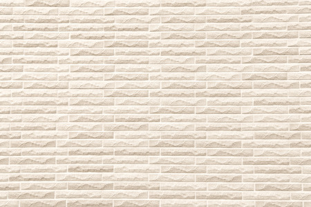 beige: closeup surface of light beige brick wall texture or pattern for background and material concept