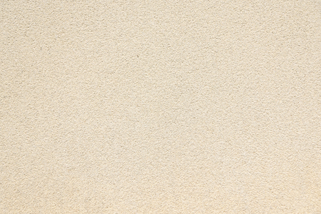 rough surface detail of beige plaster wall texture background, use for backdrop or design element