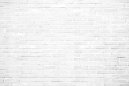 Struttura o modello bianca del muro di mattoni del grunge per fondo e concetto materiale