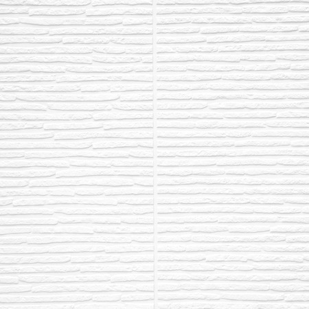 stamped: Abstract stamped pattern surface detail of white plaster wall texture background, use for backdrop or design element Stock Photo