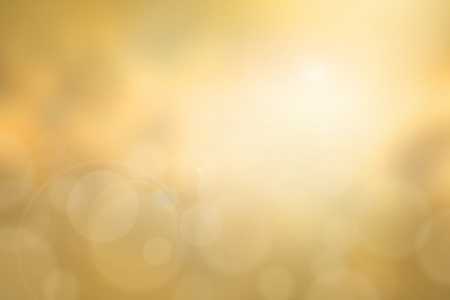 enviro: Abstract yellow sunset blurred background with bright sunlight, flare and bokeh effect, use for backdrop or design element in summer environment concept Stock Photo