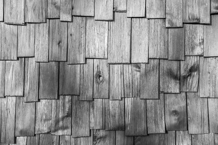 closeup surface detail of gray (grey) wood shingle tiles roof texture - use for pattern background in architecture design concept Stock Photo
