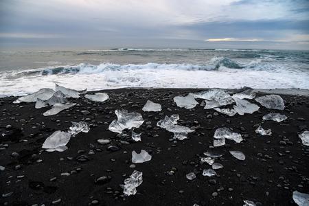 iceberg: Icebergs on black volcanic sand beach near Jokulsarlon glacier lagoon, Southern Iceland