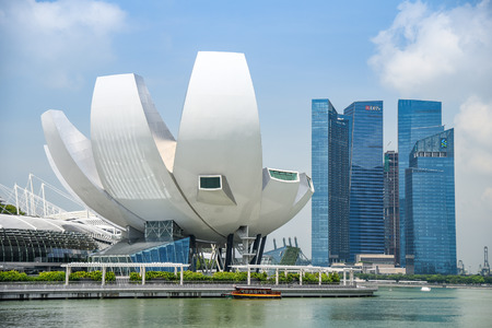 SINGAPORE - MAY 6, 2016 : Cityscape of Singapore Skyline and Art Science museum at Marina Bay Sands, one of famous tourist attraction in Asia.