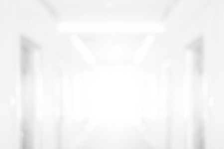 Abstract blur white room or corridor with light at the end wall - use for background or backdrop for your design element Zdjęcie Seryjne