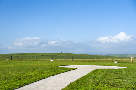 Helicopter landing platform on beautiful green field and blue sky, summer landscape in Victoria, Australia
