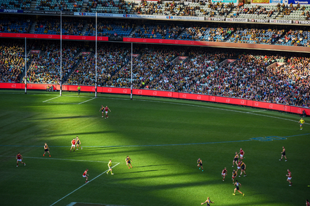 afl: MELBOURNE, AUSTRALIA - JULY 16, 2016 : Australian football or footy, favourite aussie sports at Melbourne Cricket Ground (MCG) Stadium in Yarra Park of Melbourne, Victoria, Australia. Editorial