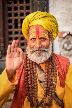 sadhu: KATHMANDU, NEPAL - APRIL 17, 2016 : Portrait of Shaiva sadhu (holy man) with traditional painted face in Pashupatinath Temple.