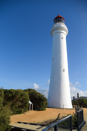 split road: Split Point Lighthouse under beautiful blue sky at Aireys Inlet, a small town on the Great Ocean Road, Victoria, Australia