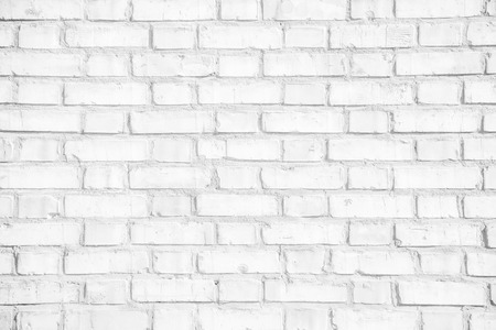 Abstract weathered white grunge brick wall texture or old surface pattern for vintage interior room background and backdrop, architectural element in urban concept
