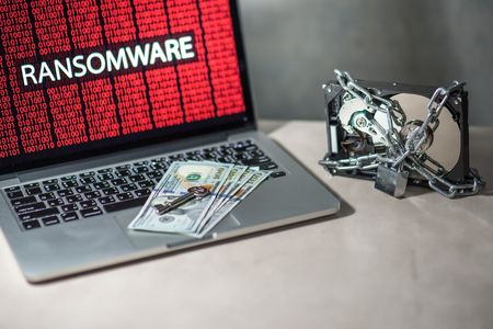 Hard disk file locked with monitor show ransomware cyber attack internet security breaches. Malware lock file concept for security article i.e. WannaCry or WannaCrypt attack all over the world