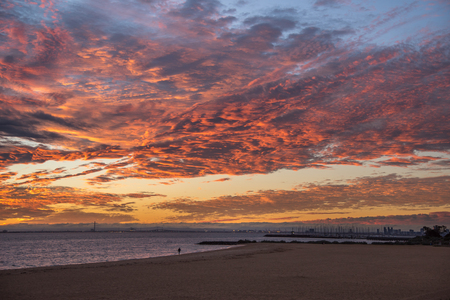 brighton: impressive sunset sky with red abstract clouds at Brighton Beach, famous place near Melbourne city, Australia Stock Photo