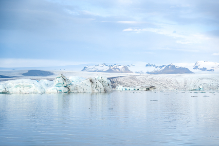 Iceberg in Jokulsarlon glacier lagoon originating from the Vatnajokull (the biggest glacier in Europe), beautiful nature landscape in winter season of Iceland Stock Photo - 81922338