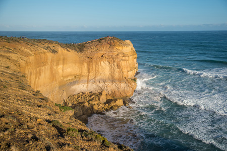 High cliff near Great Ocean Road and the Twelve Apostles, natural landmark and tourist attraction of Victoria, Australia Stock Photo