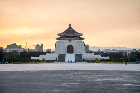 TAIPEI, TAIWAN - FEBRUARY 15, 2017 : Soldier raise the flag in the morning at Chiang Kai-shek memorial hall, a famous monument, tourist attraction and landmark of Taipei, Taiwan.