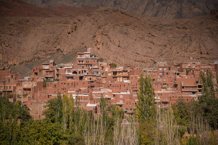 esfahan: Red mud brick houses of Abyaneh Village, Iranian historical villages, located at the foot of Karkas Mountain in Natanz, Isfahan province, Iran