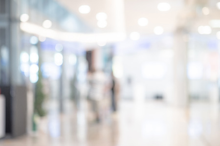 Abstract blurred shopping mall or department store. Blur hospital hall interior space. Defocused public building background or backdrop for business and health concepts