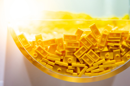 Close up of plastic toy bricks inside self service container shelf display in Kids toy store.