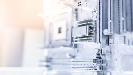 Close up of silver computer mainboard or metallic electronic circuit board. Use for background or backdrop in futuristic hardware technology concept