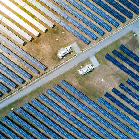 Aerial view of Solar panel farm or solar power plant. Alternative renewable energy with photovoltaic cell industry. Green energy technology for future concept
