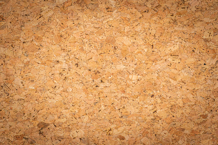 Abstract brown corkboard or cockboard texture background. Natural wood surface for material design element. Beige cork board wallpaper 写真素材
