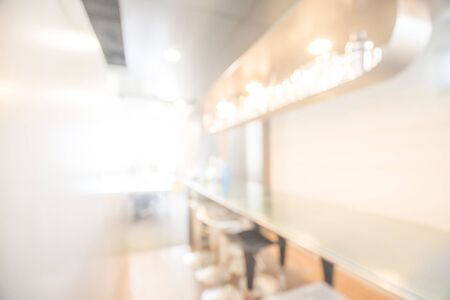 Abstract blurred bar counter interior. illuminated blurry pub and restaurant with defocused effect. Blur background or backdrop for food and drink business concept