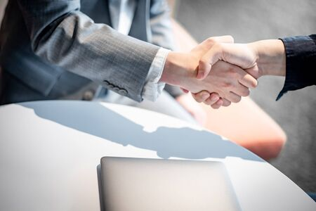 Business agreement and collaborative partnership concept. Business people shaking hands at meeting.  Asian businessman partner handshake.