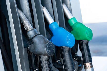 Oil fuel filling nozzles at petrol pump. Fuel dispenser in gas station. Energy industry concept Reklamní fotografie