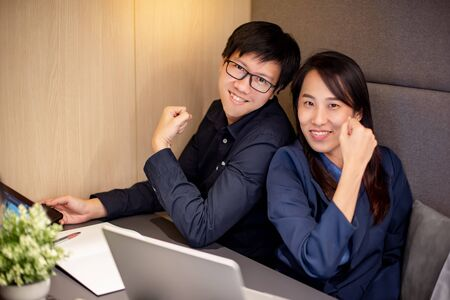Smiley Asian Businessman and businesswoman making conference in office meeting room. Office worker colleagues working together at workplace. Smart business team concept