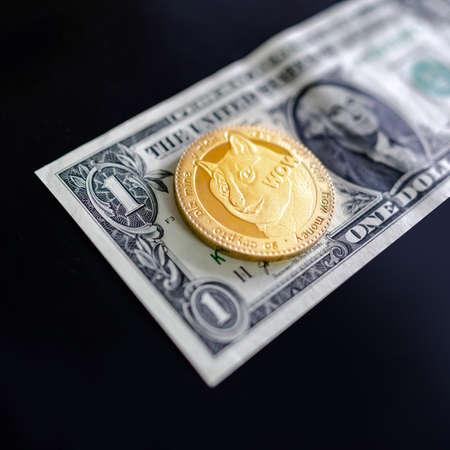 Gold Dogecoin on one dollar banknote. DOGE road to 1 dollar. The  most popular meme crypto coin in cryptocurrency world. Zdjęcie Seryjne