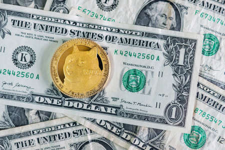 Gold Dogecoin on one dollar banknotes. DOGE road to 1 dollar. The most popular meme crypto coin in cryptocurrency world.