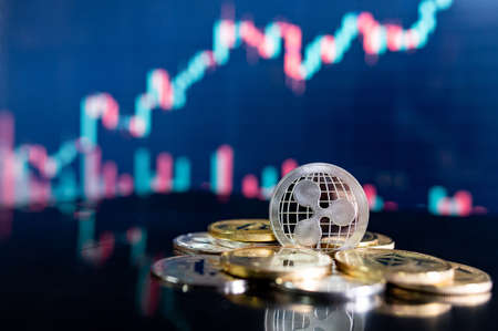 Ripple (XRP) and other crypto coins with blurred candlestick chart. Cryptocurrency and decentralized finance concept Zdjęcie Seryjne