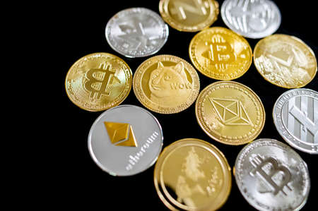 Decentralized finance concept. Different cryptocurrency coins on black background. Bitcoin, Ethereum, Ripple, Dogecoin, Litecoin, Zcash. Zdjęcie Seryjne