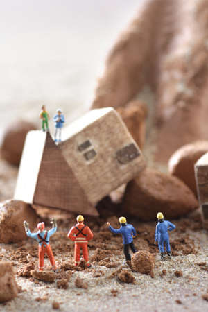 Diorama model of houses and rescuers collapsed in mudslide