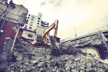 Demolition site for rebuilding city buildings using shovel cars