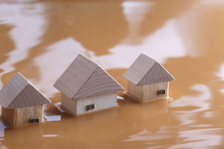 Homes submerged by river flooding and isolated people