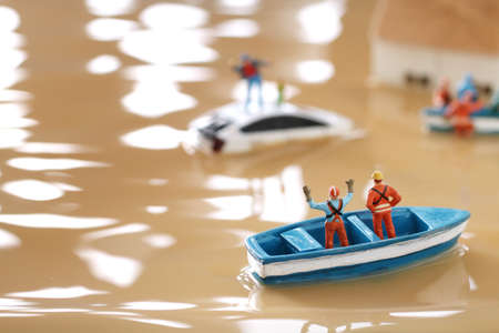 Diorama of rescuers heading to rescue by boat with people unable to evacuate because of flood damage