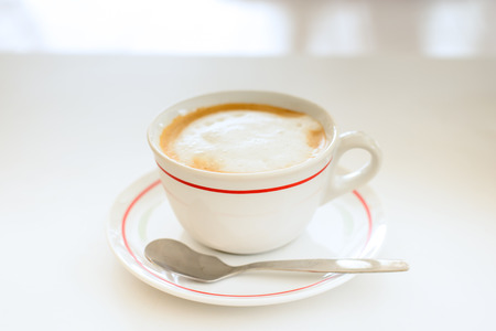 cappucino: Mocha coffee drink on a white table. Stock Photo