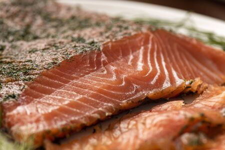 dried smoked salmon gravlax with dill on a white platter close up macro Stock fotó