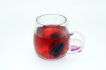 Glass of red fruit tea isolated on white background Stock Photo
