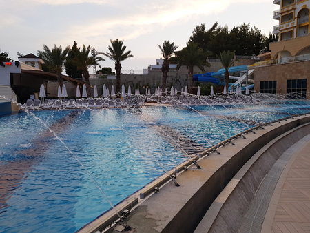 Swimming pool in a hotel complex in Turkey Editorial