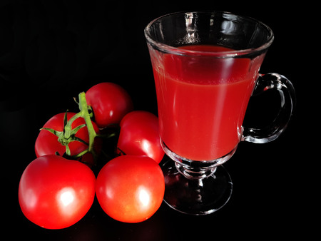 Tomato juice in glass isolated on black background Stock Photo