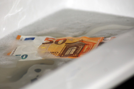 Money laundering euro bills in the sink