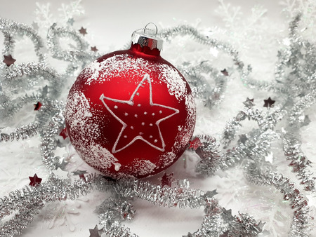 Christmas tree ball red on white star. Background