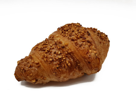 Lekeres croissant with nuts isolated on white background Imagens