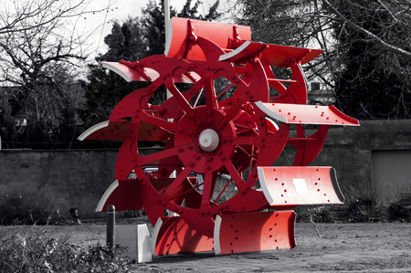 Water wheel of a paddle steamer in black and white red