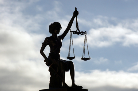 Lady Justice released under the sky