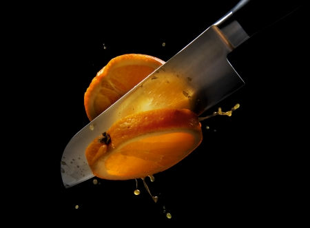 Knife cuts of juicy orange photo
